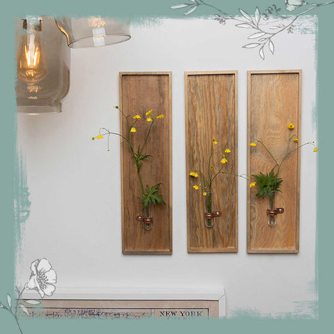 Floral wall frames hanging on a wall.