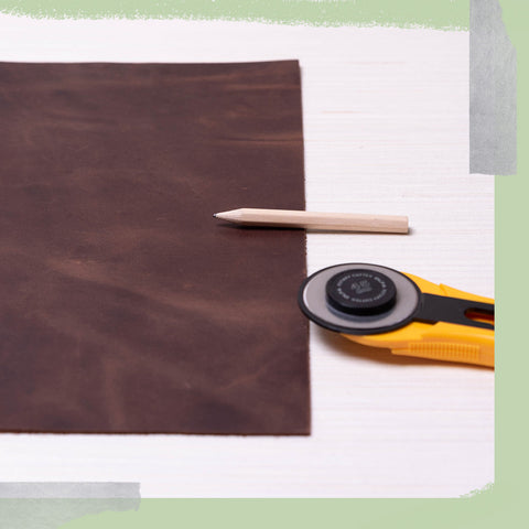 Leather, a pencil, and a rotary cutter.