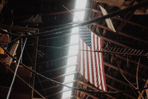A flag hanging in a building.