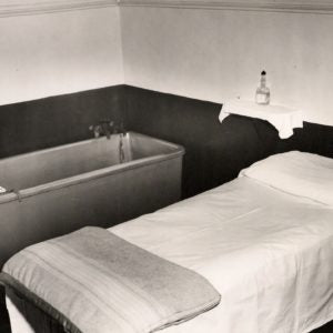 A massage table and spa bath.