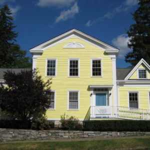 A yellow house is used as a spa in modern day Sharon Springs.