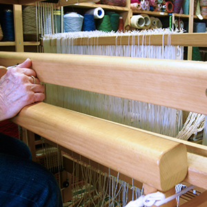 The front of a loom.