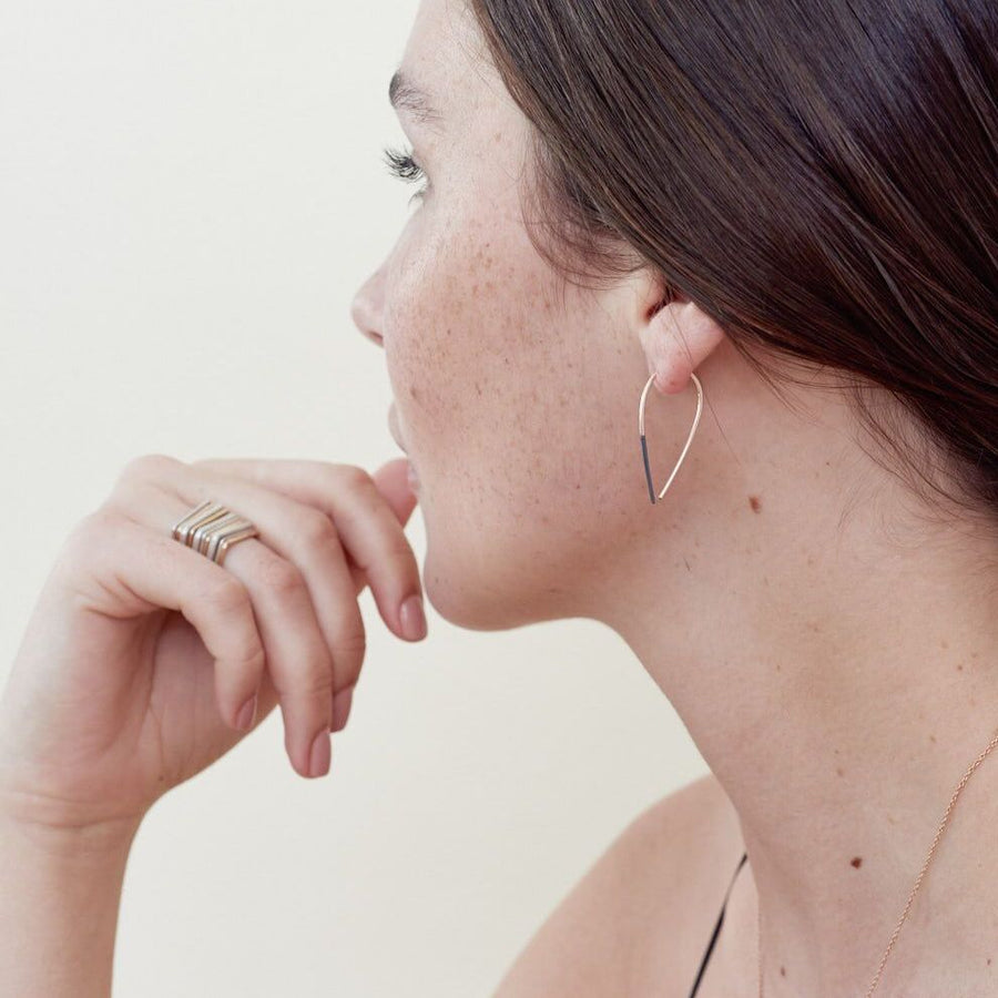 Teardrop Pull Through Earrings - Black and Yellow Gold (on model)