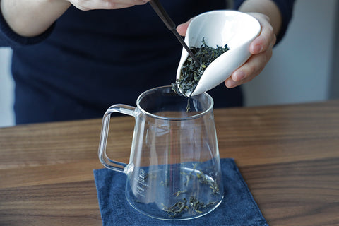 adding tea pitcher