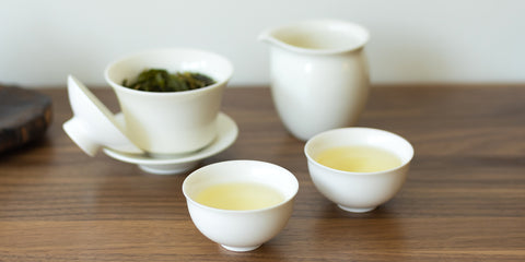 two cups and green tea gaiwan