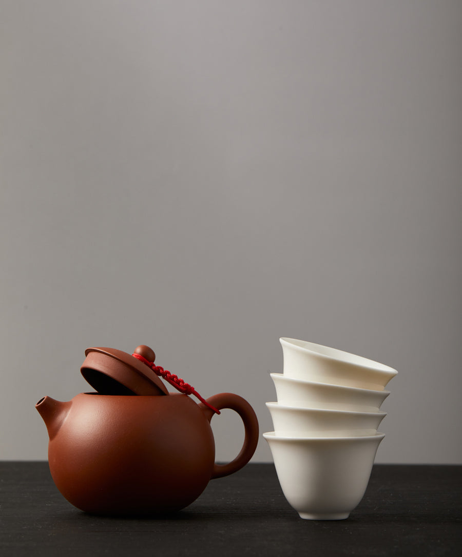 clay teapot and cups