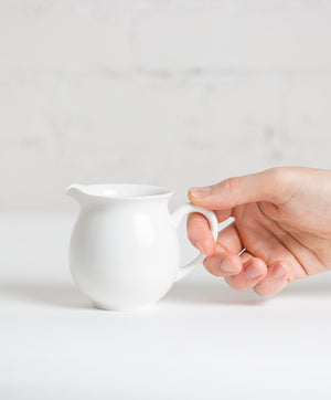 hand holding taiwanese pitcher 9oz