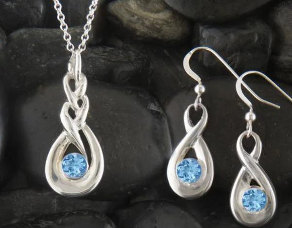 Walker Metalsmith's Handcrafted Celtic Birthstone Jewelry for March is Simulated Aquamarine