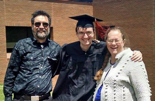 Steve & Sue with their son Donald at his college graduation