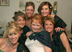 A bride & her bridesmaids in tartans & celtic brooches