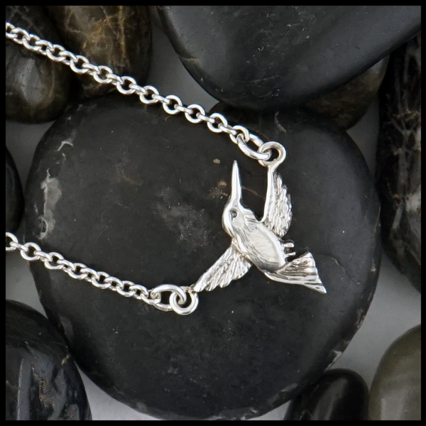 "Hummingbird in Sterling Silver with an option for 16"" or 18"" Cable Chain."