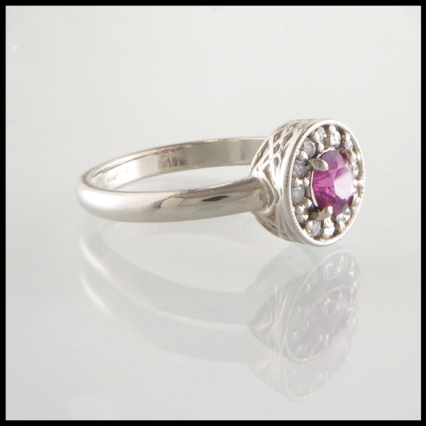 Pink Sapphire and Diamond halo engagement ring