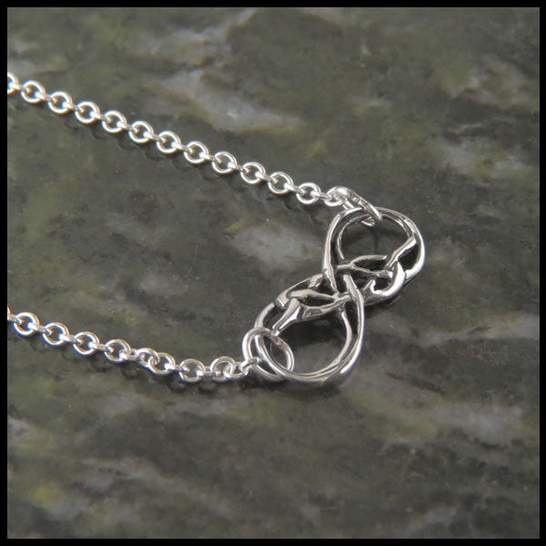Infinity Knot pendant in Sterling Silver handcrafted by Walker Metalsmiths