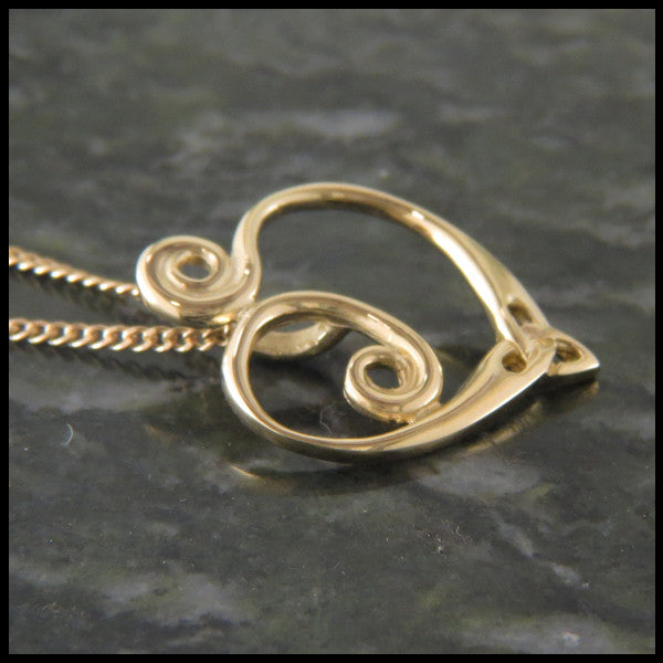 Celtic spiral heart pendant in 14K Gold custom designed by Walker Metalsmiths
