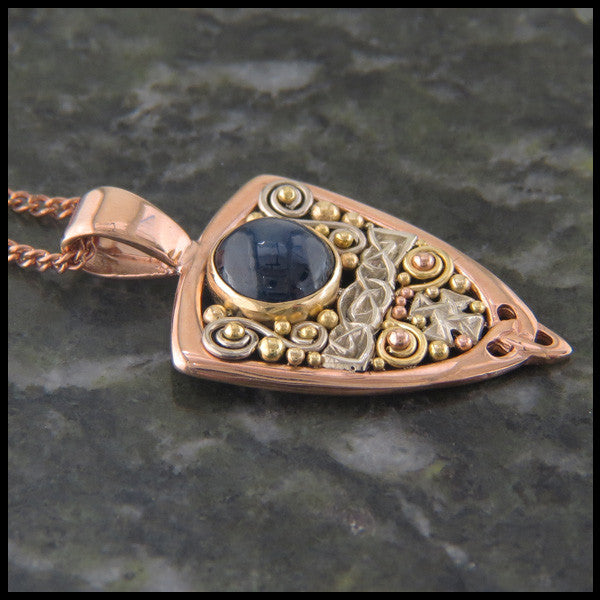 Gold Celtic pendant with Sapphire