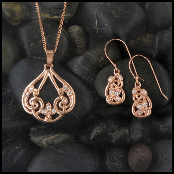Intricate 14K Gold pendant and earring set with milligrain and diamonds