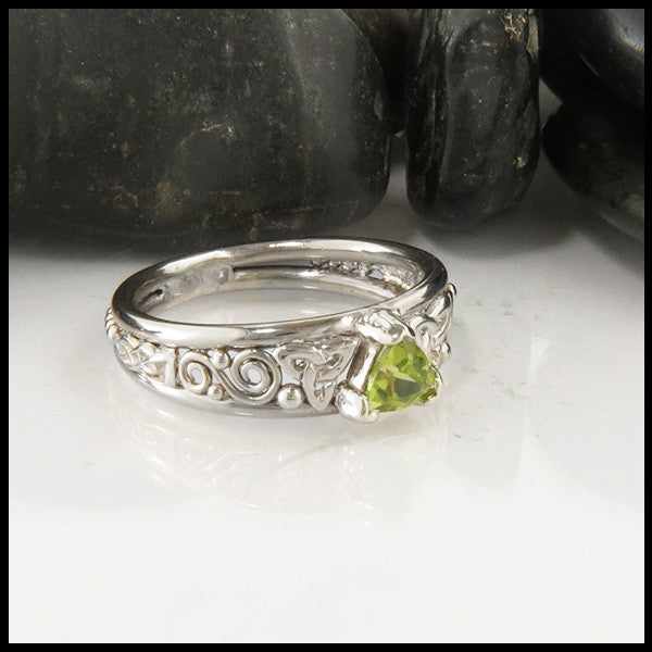 Trilliant Peridot Celtic Ring in White Gold