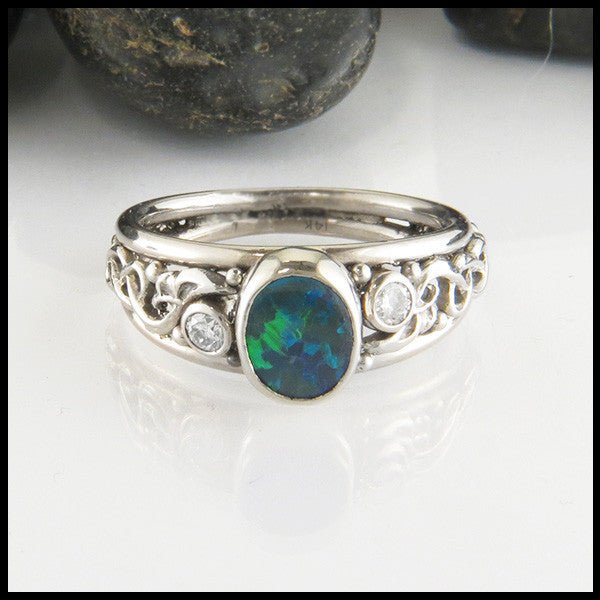 Celtic black opal and diamond ring in white gold