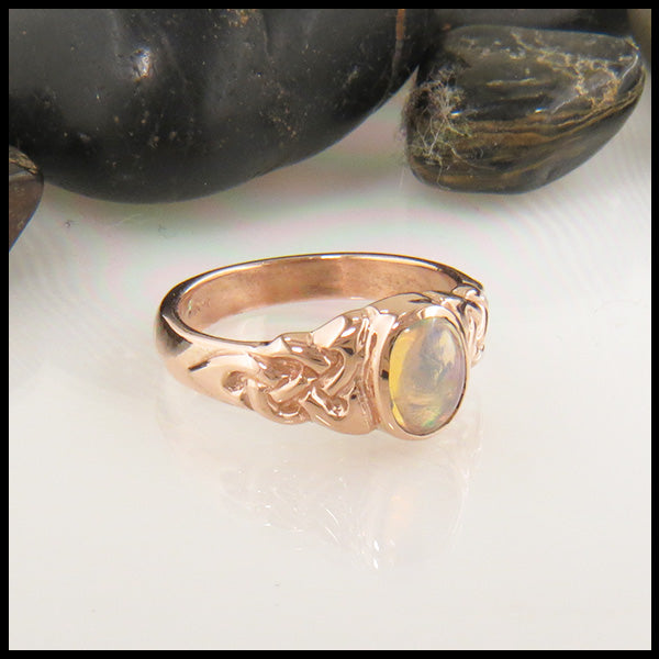 Celtic Trinity Ring with Oval Opal in Gold