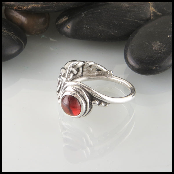 Asymmetrical Celtic Ring in Sterling Silver with Garnet