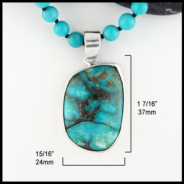 15/16 inch by 1 7/16 inch Beaded Turquoise pendant and necklace