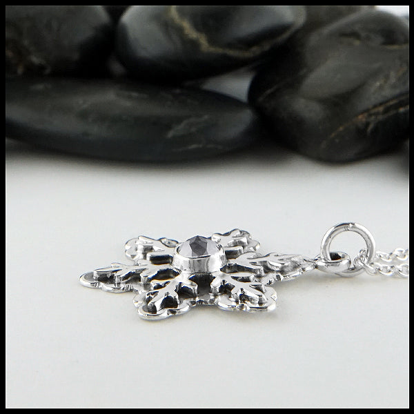 Profile view of salt and pepper diamond snowflake