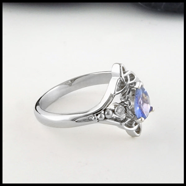 Profile view Trinity Knot and Blue Sapphire ring