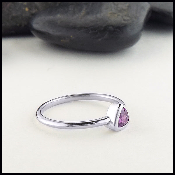 Profile view of trillion purple sapphire ring