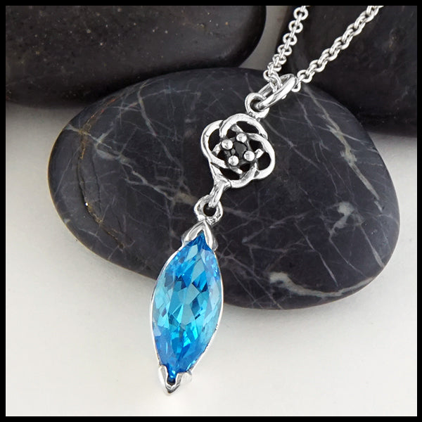 Profile view Blue Topaz with Josephine's Knot Pendant