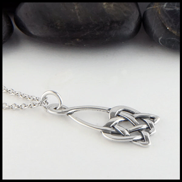 Profile view open heart knot pendant
