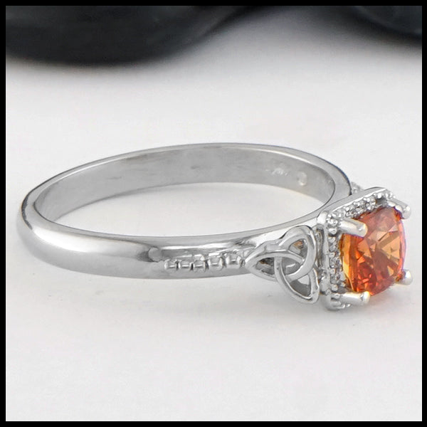 Profile view of Orange Sapphire Gold Ring