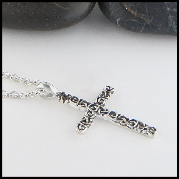 Profile view of Trinity Scroll Cross in Sterling Silver