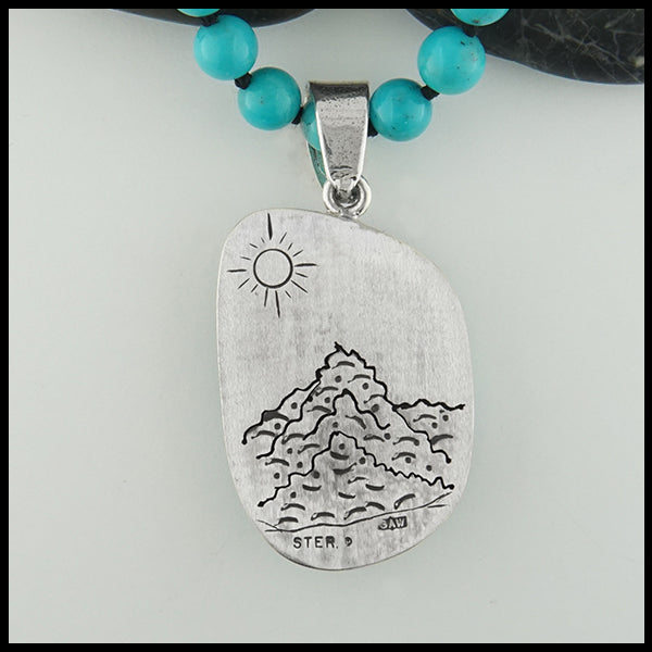 Rear view of pendant engraved design