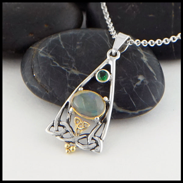 Profile view Opal and Tsavorite Trinity Knot Pendant