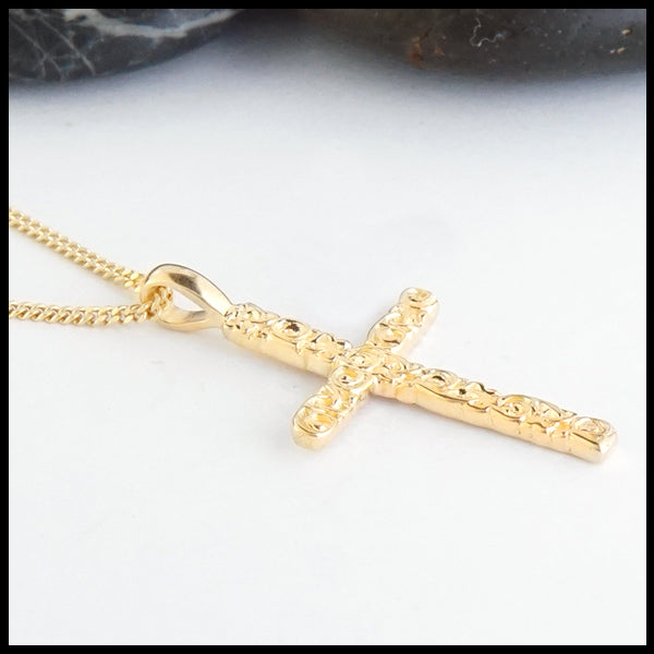 Profile view of Trinity Scroll Cross in 14K Gold
