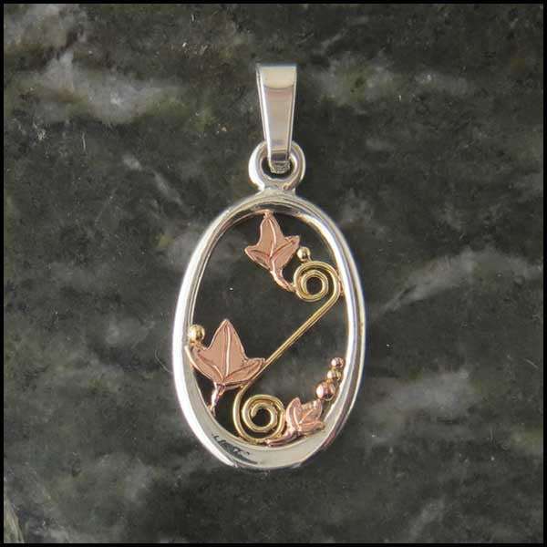 Oval Celtic pendants in Sterling Silver and Gold