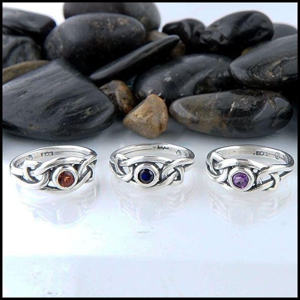 Celtic knot ring with gemstone in sterling silver