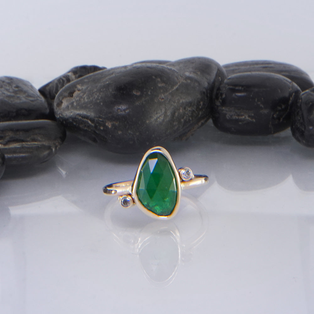 Tsavorite and yellow gold ring by walker metalsmiths