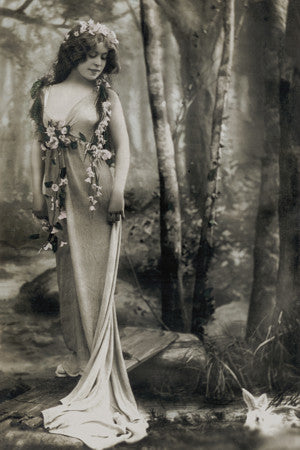 Antique photograph of an Edwardian woman in the forest with a rabbit. Fine art print