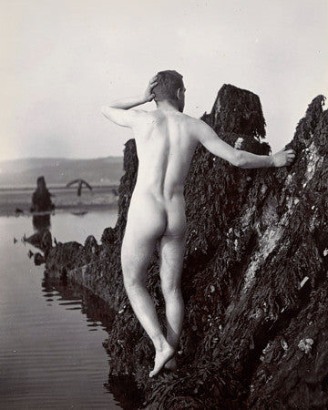 Vintage photograph of a male nude by the seaside. Fine art print