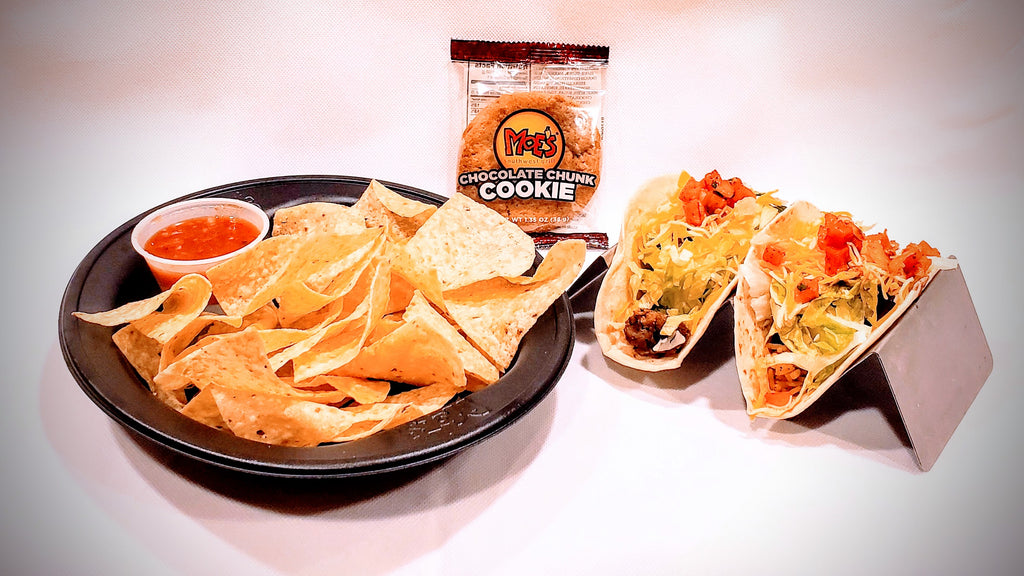 A serving includes Grilled Steak, Shredded Cheese, Salsa, Black Beans, Rice, Sour Cream, Chips & a Cookie.