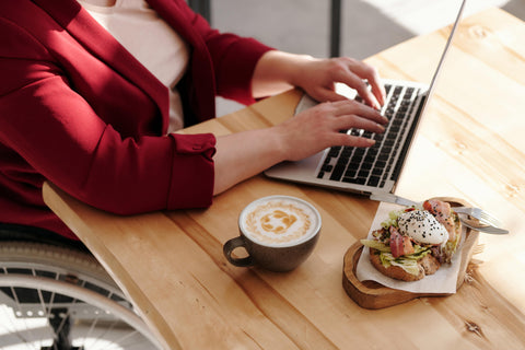woman eating with laptop virtual brunch social distancing