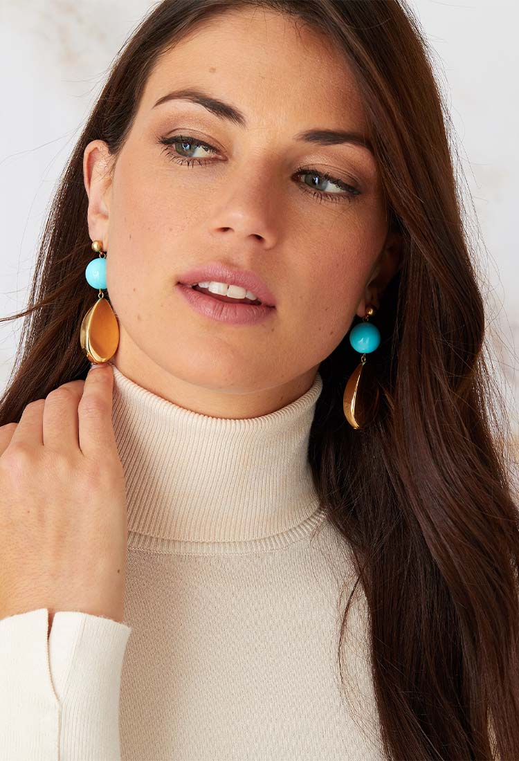 a pair of luxury Italian blue and gold statement earrings made of resin