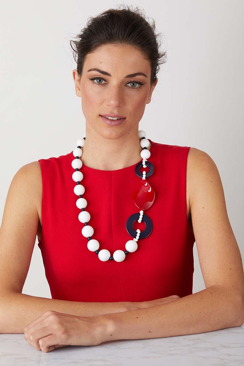 a luxury Italian white, blue and red statement necklace made of resin