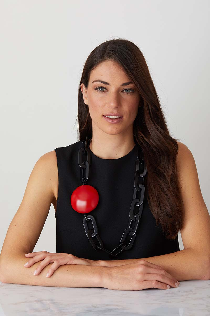 Black Red Chain statement necklace worn by a model in a  black evening dress