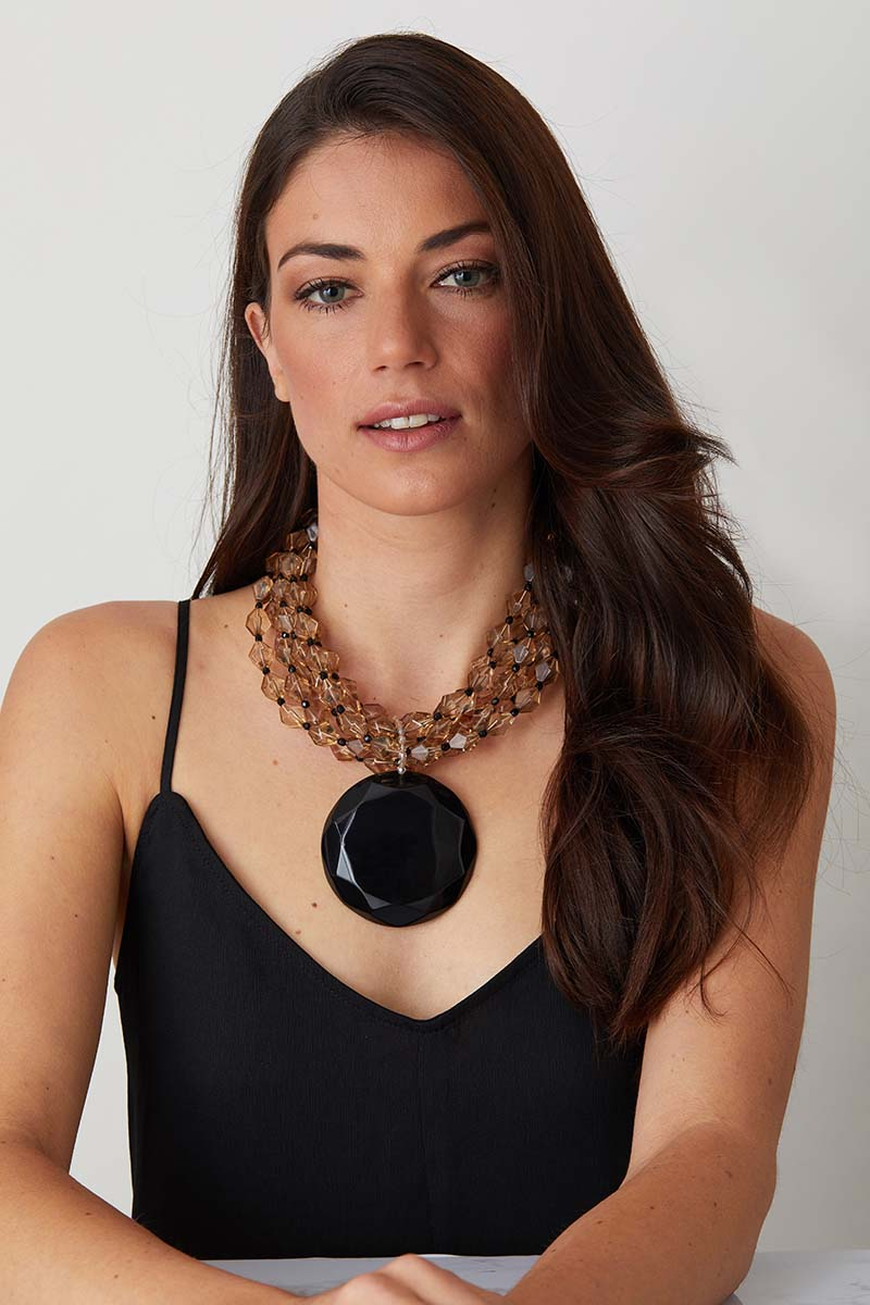 Crystal black statement necklace worn by a model in a black evening dress