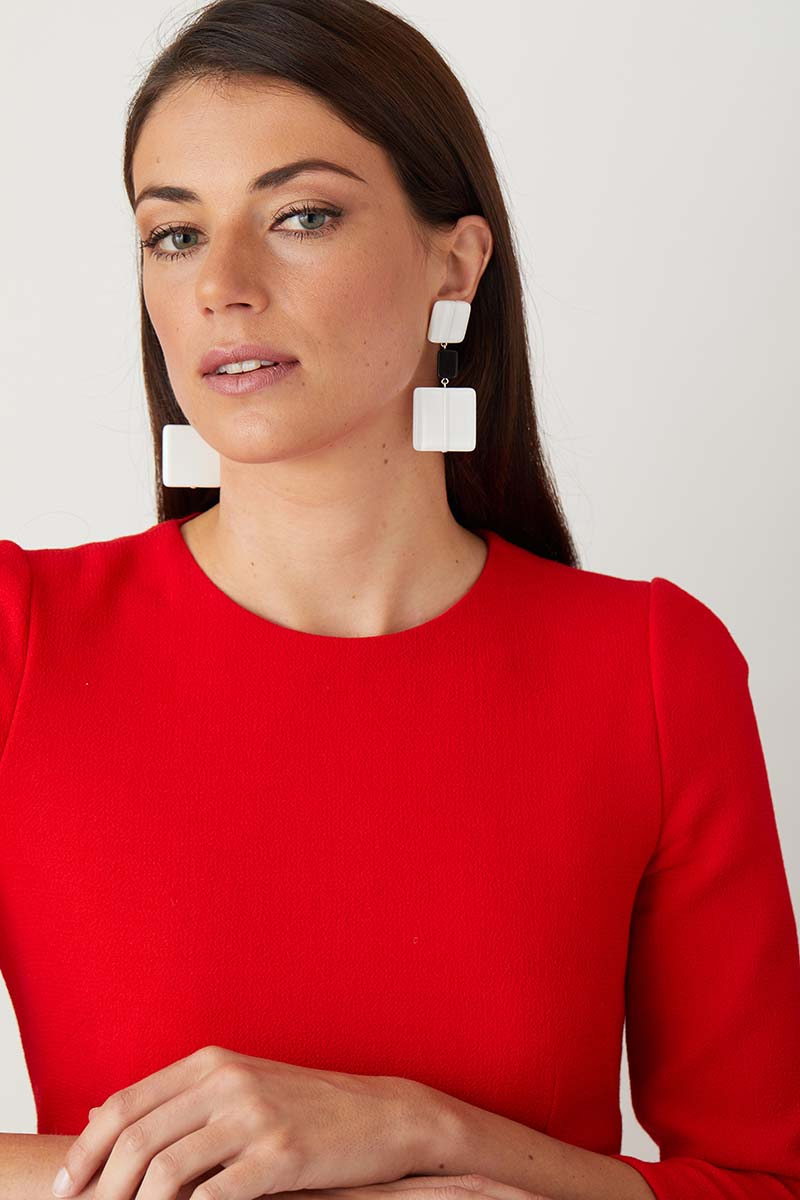 a pair of luxury Italian white and black statement earrings made of resin