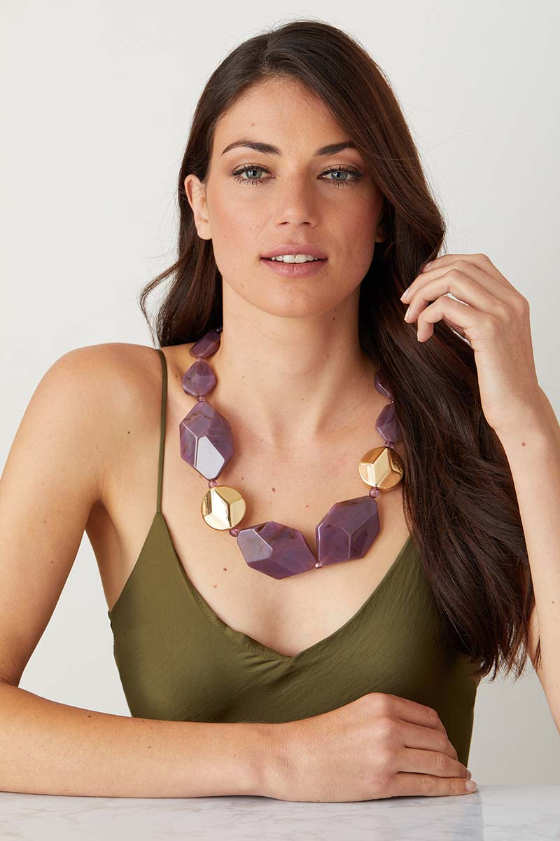 Purple Gold statement necklace worn by a model in a green summer dress