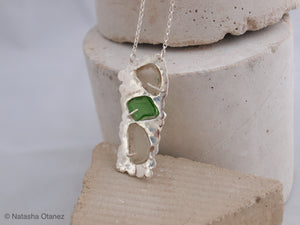 Silver pendant with white and green seaglass