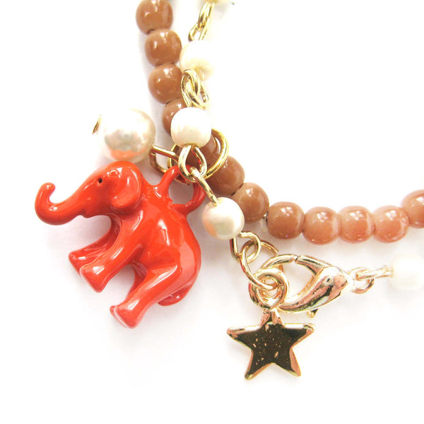 elephant-charm-animal-stretchy-bracelet-in-bright-orange-on-brown